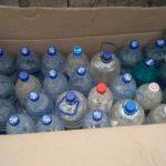 """В Бельцах два """"бизнесмена"""" собирались продать более 180 литров контрафактного алкоголя, но полиция разрушила их планы (ФОТО)"""