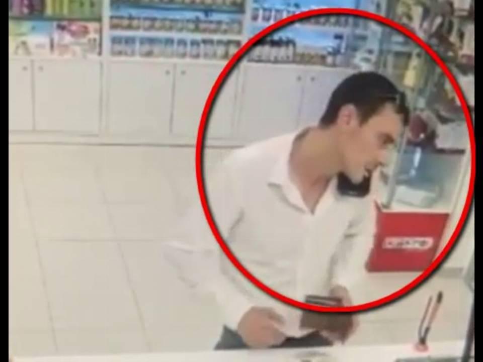 В столице разыскивают подозреваемого в краже телефона, забытого в аптеке (ВИДЕО)